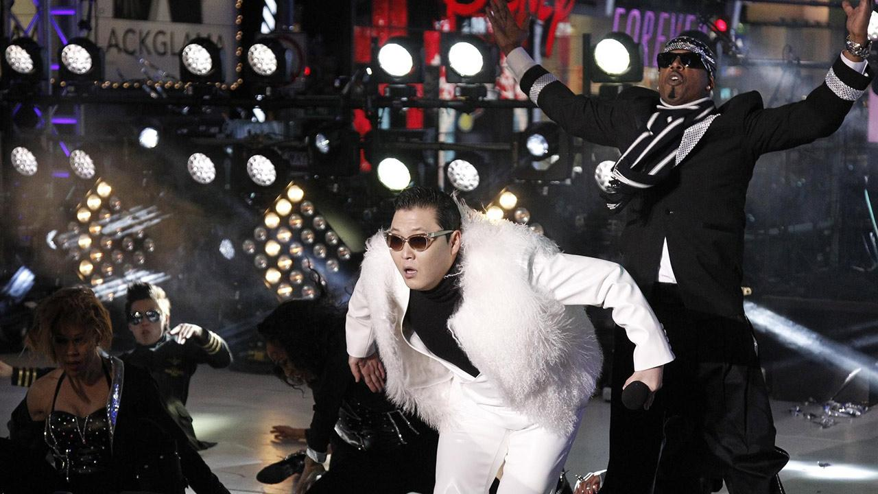 PSY and MC Hammer perform Gangnam Style at the Dick Clarks New Years Rockin Eve concert and special in New York City on Dec. 31, 2012.