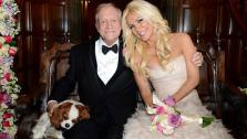 Hugh Hefner and Crystal Harris pose with their Cavalier King Charles Spaniel Charlie for an official wedding photo. The two tied the knot at the Playboy Mansion on Dec. 31, 2012 -- New Years Eve. - Provided courtesy of Elayne Lodge / Playboy Enterprises, Inc.