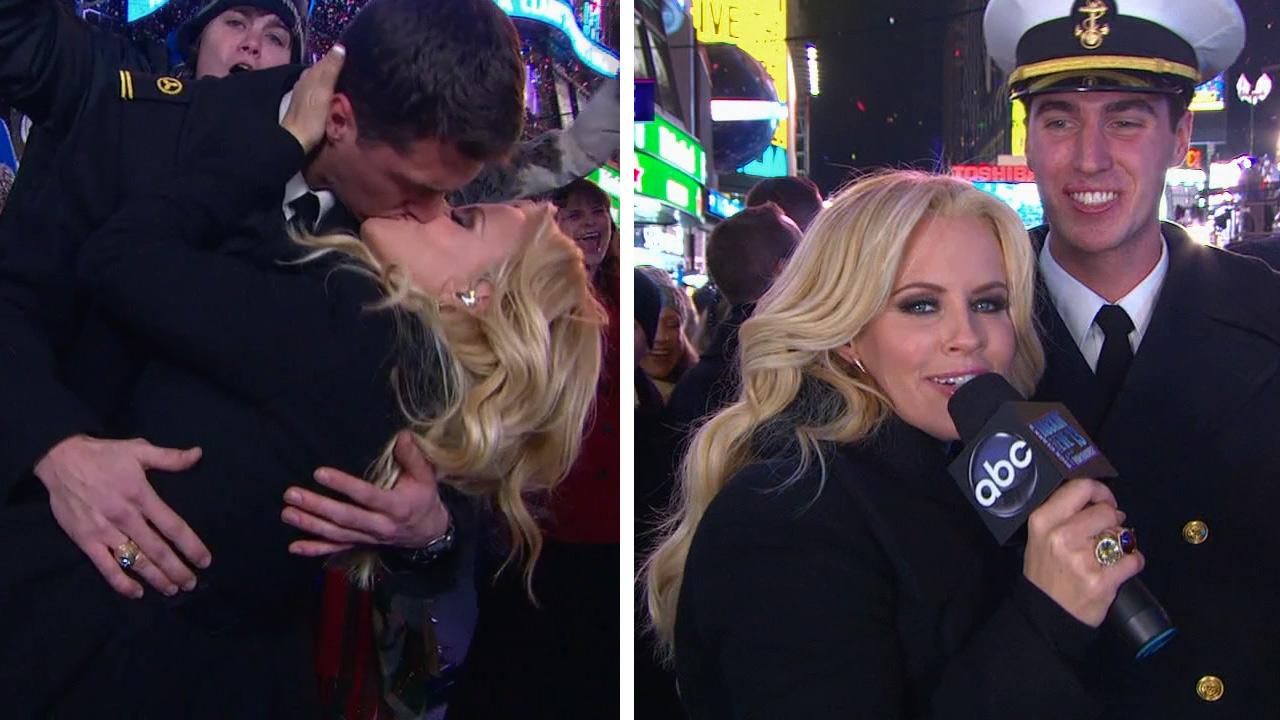Jenny McCarthy kisses and poses with U.S. Navy member Benjamin Moore on Dick Clarks New Years Rockin Eve on Dec. 31, 2012.