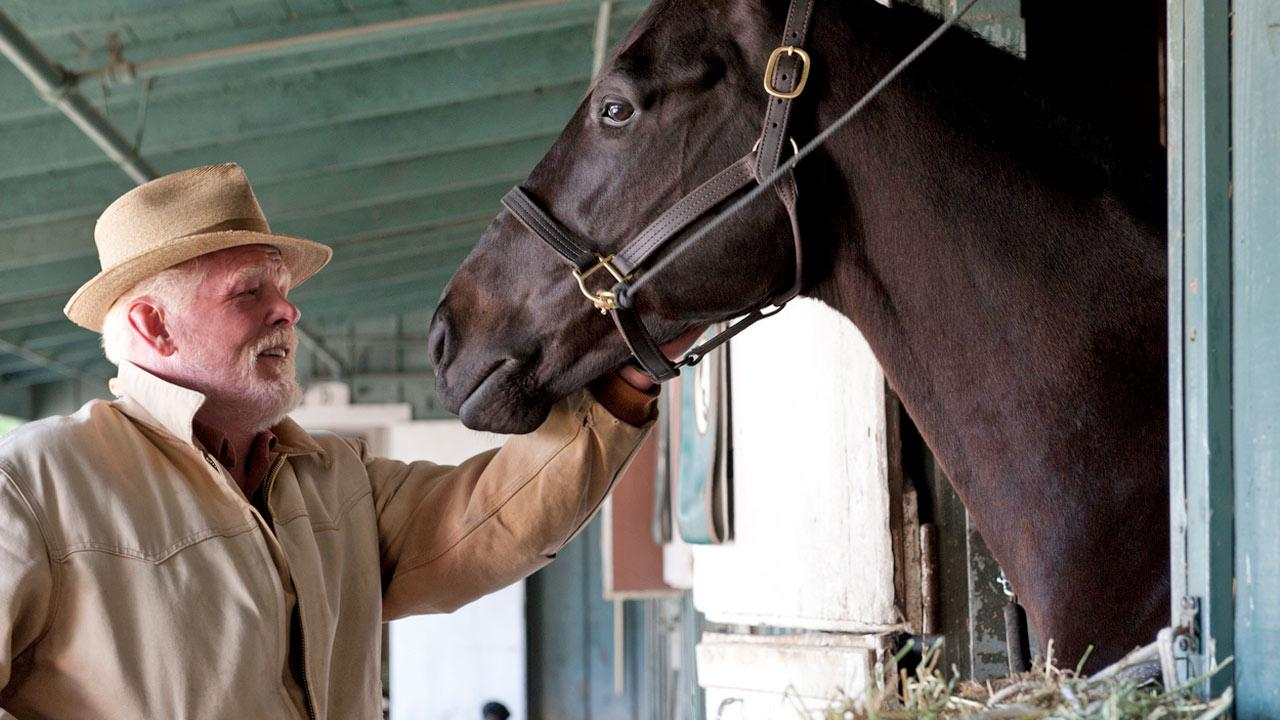 A horse and Nick Nolte appear in a scene from the HBO series Luck in 2011.