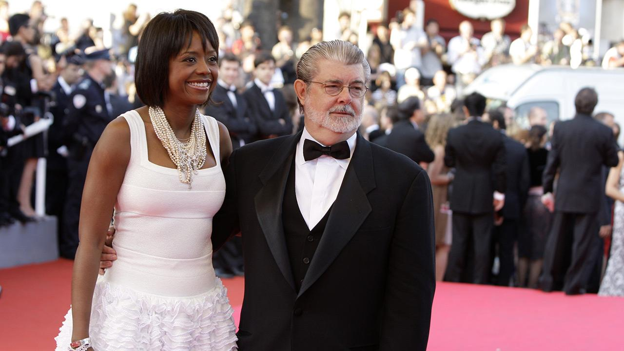 George Lucas, right, and his girlfriend Mellody Hobson arrive for the premiere of the film Kung Fu Panda, during the 61st International film festival in Cannes, southern France, on May 15, 2008.