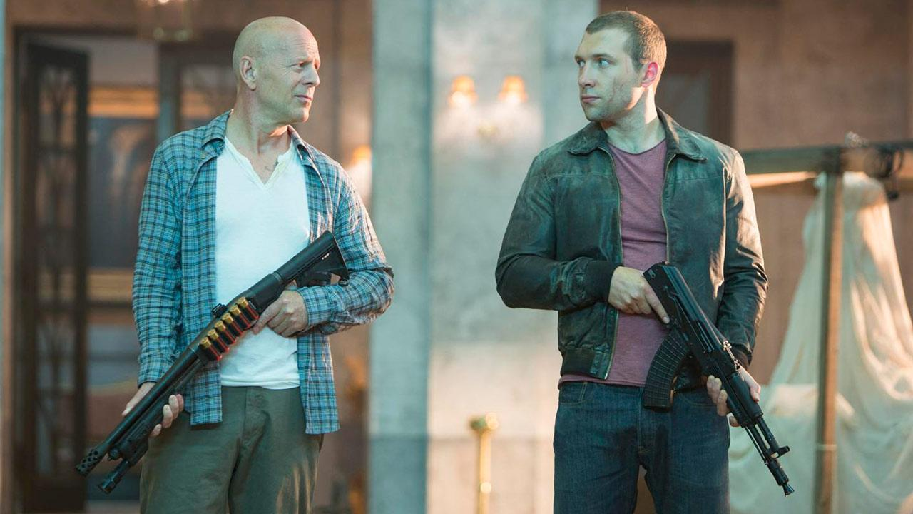 Bruce Willis and Jai Courtney appear in a scene for the 2013 film A Good Day to Die Hard.
