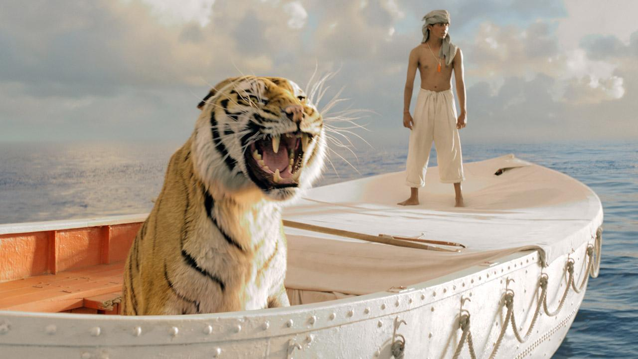 Suraj Sharma appears in a scene from the 2012 film Life of Pi. / Ang Lee appears on the set of Life of Pi.Jake Netter / Twentieth Century Fox Film Corporation
