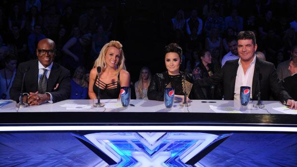 L.A. Reid, Britney Spears, Demi Lovato and Simon Cowell appear on FOXs The X Factor on Nov. 28, 2012. - Provided courtesy of Ray Mickshaw / FOX
