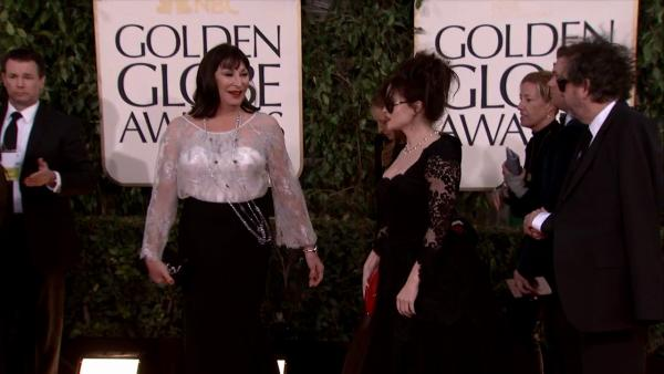 Anjelica Huston appears with Helena Bonham Carter and Tim Burton at the 2013 Golden Globe Awards in Beverly Hills, California on Jan. 13, 2013.