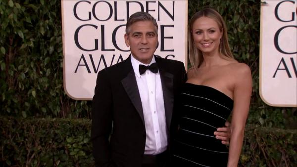 George Clooney and Stacy Keibler appear at the 2013 Golden Globe Awards in Beverly Hills, California on Jan. 13, 2013.