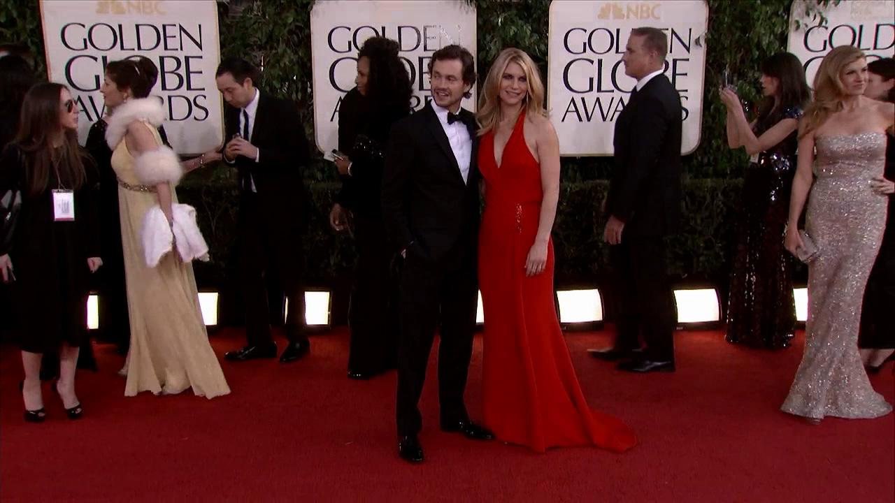 Claire Danes and husband Hugh Dancy appear at the 2013 Golden Globe Awards in Beverly Hills, California on Jan. 13, 2013.