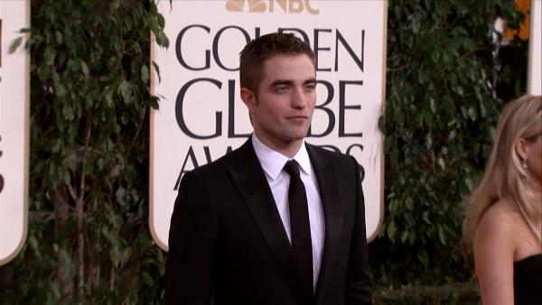 Robert Pattinson walks the 2013 Golden Globes red carpet