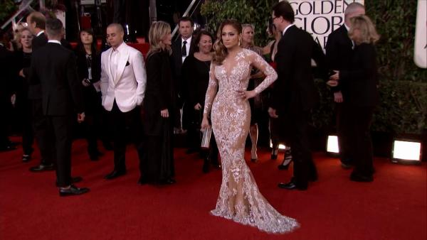 Jennifer Lopez appears at the 2013 Golden Globe Awards in Beverly Hills, California on Jan. 13, 2013. Her boyfriend, Casper Smart, is picture on the left.