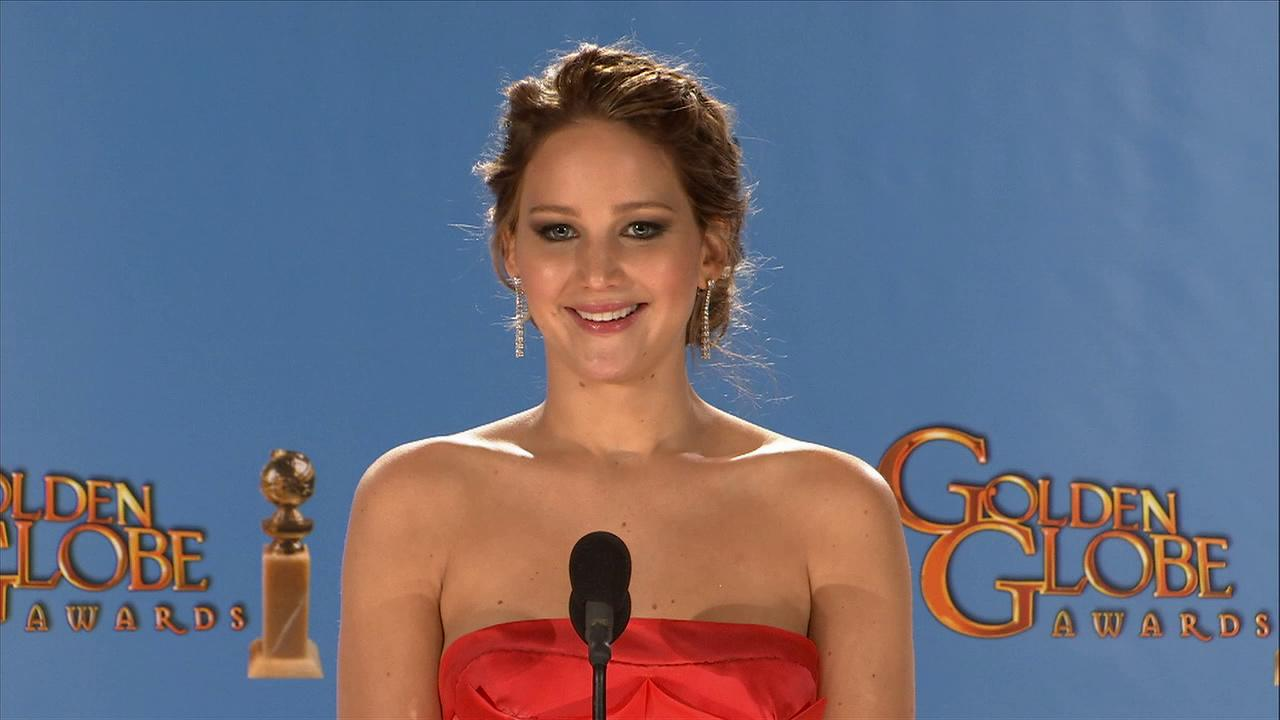 Jennifer Lawrence talks to reporters backstage at the 2013 Golden Globes on Jan. 13, 2013.