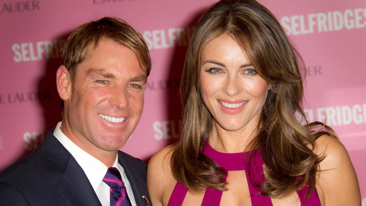 Elizabeth Hurley and former Australian cricket player Shane Warne seen at Londons Selfridges department store before she signs products in support of Breast Cancer Awareness on Monday, October 8, 2012 in central London, UK.