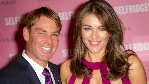 Elizabeth Hurley and former Australian cricket player Shane Warne seen at Londons Selfridges department store before she signs products in support of Breast Cancer Awareness on Monday, October 8, 2012 in central London, UK. - Provided courtesy of Joel Ryan/Invision/AP