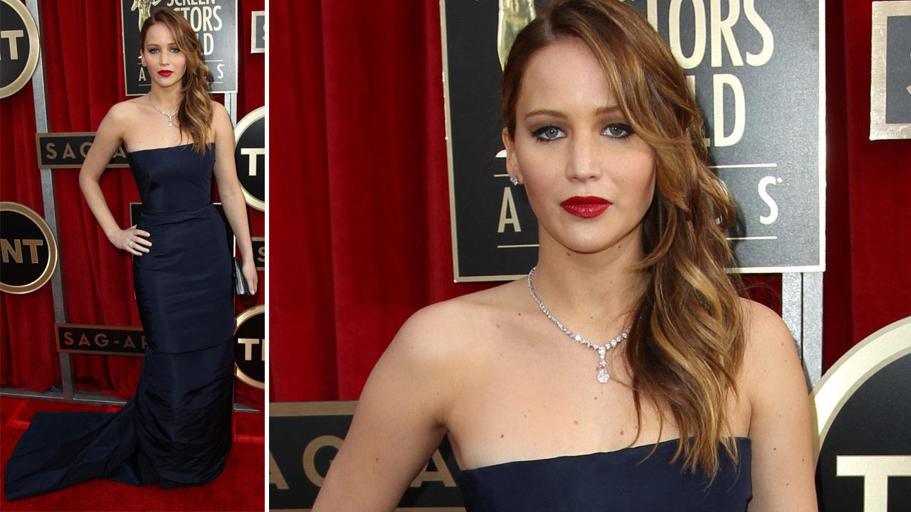 Jennifer Lawrence poses on the red carpet at the 2013 SAG Awards in Los Angeles on Jan. 27, 2013