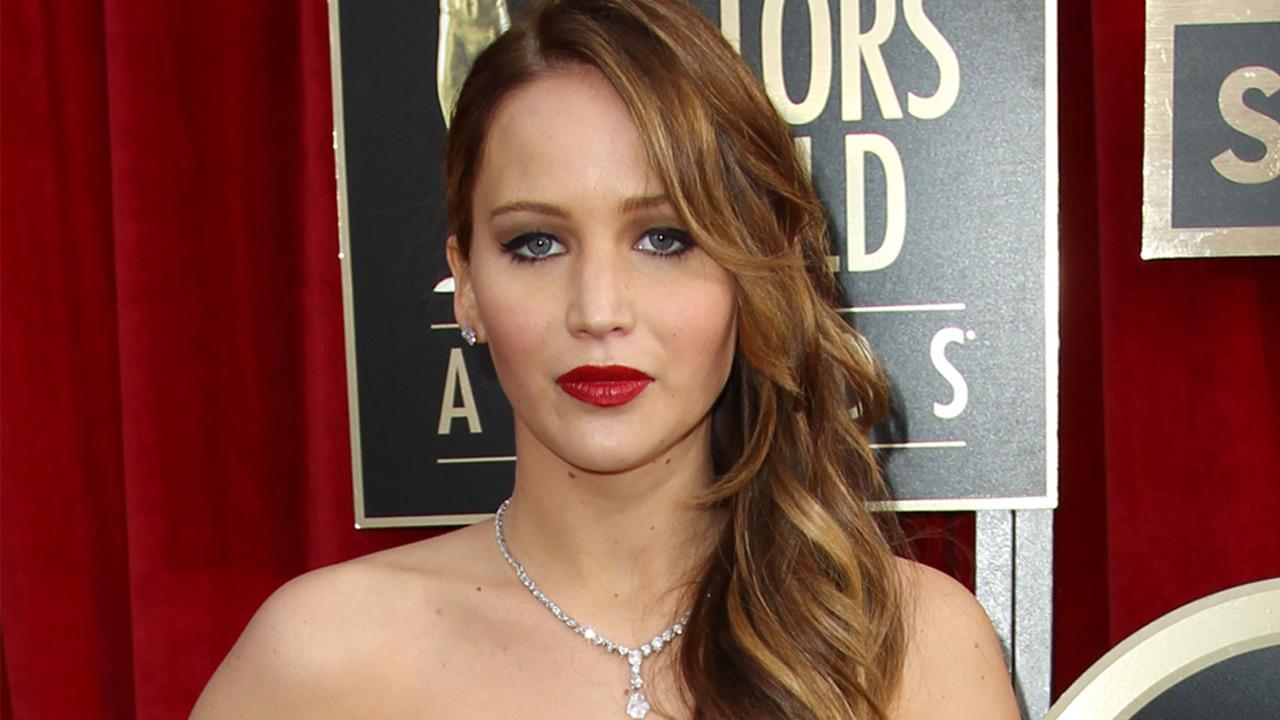 Jennifer Lawrence poses on the red carpet at the 2013 SAG Awards in Los Angeles on Jan. 27, 2013Matt Sayles / AP