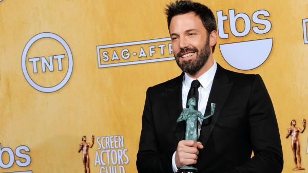 Actor Ben Affleck poses backstage with the award for best cast in a motion picture for Argo at the 19th Annual Screen Actors Guild Awards at the Shrine Auditorium in Los Angeles on Sunday Jan. 27, 2013. - Provided courtesy of Chris Pizzello / AP