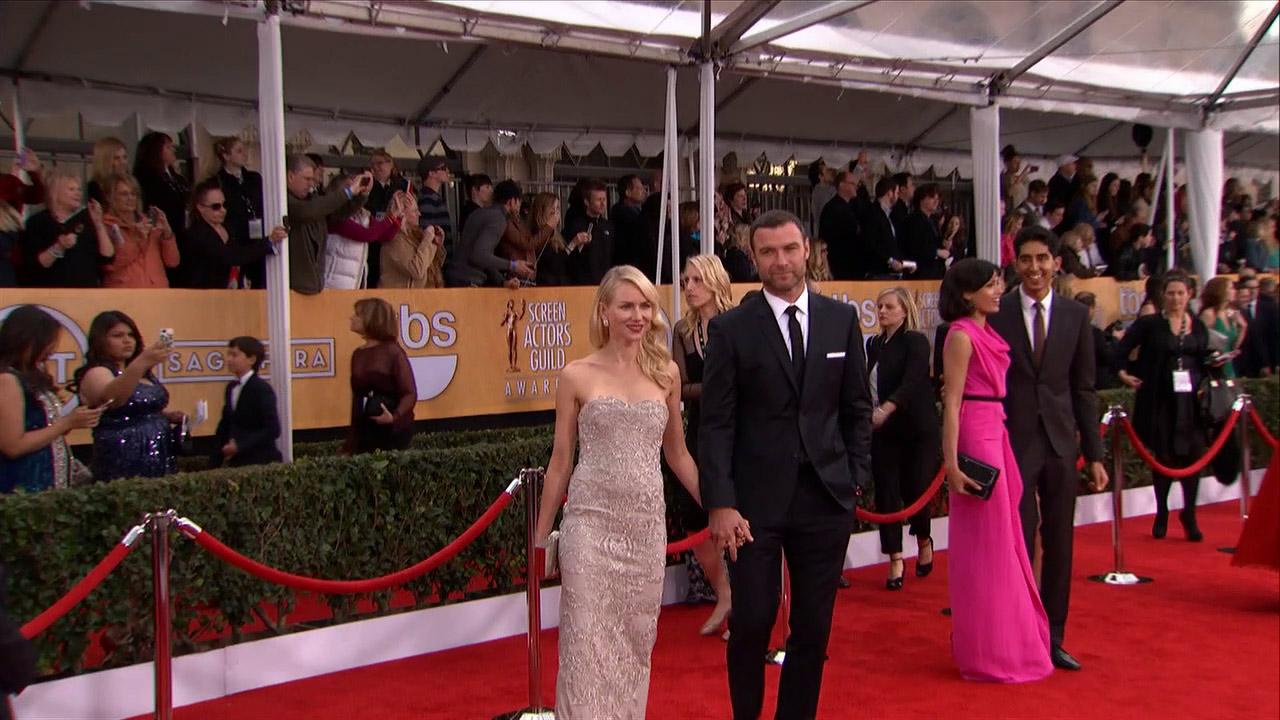 Naomi Watts and partner Lieb Schreiber pose on the red carpet at the 2013 SAG Awards in Los Angeles on Jan. 27, 2013.