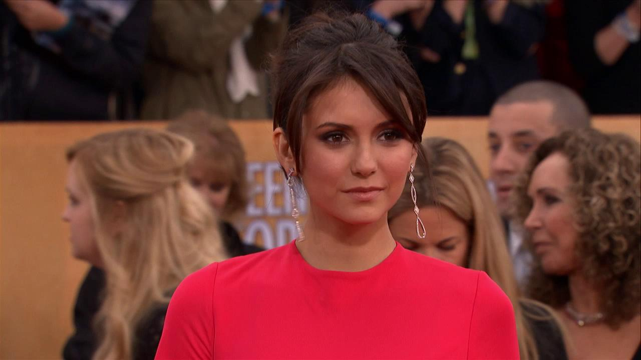 Nina Dobrev (The Vampire Diaries) poses on the red carpet at the 2013 SAG Awards in Los Angeles on Jan. 27, 2012.
