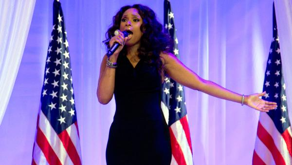 Jennifer Hudson sings as President Barack Obama and first lady Michelle Obama dance together at an Inaugural Ball, Monday, Jan. 21, 2013, at the Washington Convention Center in Washington, during the 57th Presidential Inauguration. - Provided courtesy of Carolyn Kaster