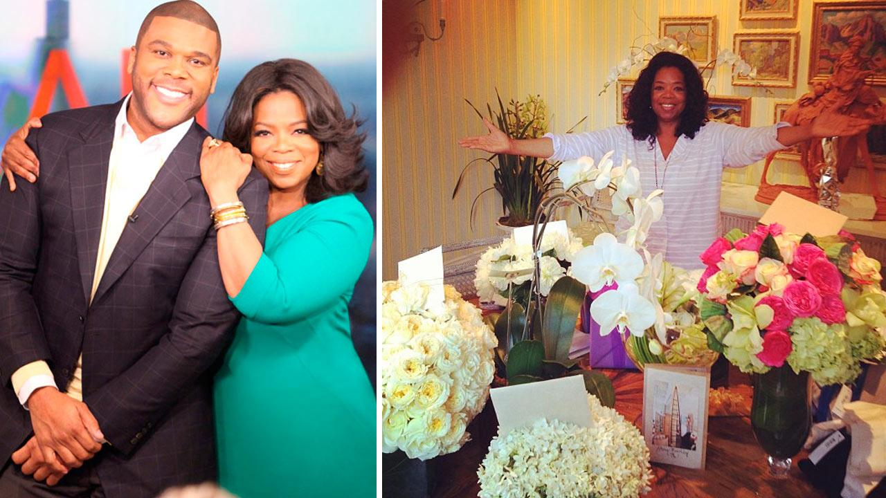 Tyler Perry and Oprah Winfrey appear in a publicity photo provided by OWN on Oct. 1, 2012. / Oprah Winfrey poses with birthday flowers on January 30, 2013.