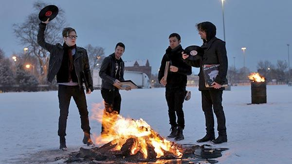 Fall Out Boy band memebers Patrick Stump, Pete Wentz, Joe Trohman, and Andy Hurley appear in a photo taken in Chicago on February 4, 2013. - Provided courtesy of falloutboyrock.com