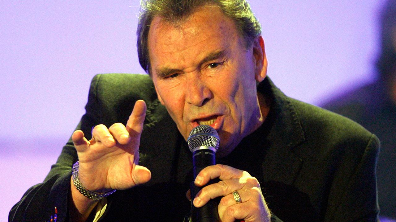 Reg Presley, frontman of British rock group The Troggs, performs in a TV studio in Huerth, near Cologne, Germany during the recording of the 50th Chart Show - The Best Rock Classics on April 29, 2008. <span class=meta>(Hermann J. Knippertz)</span>