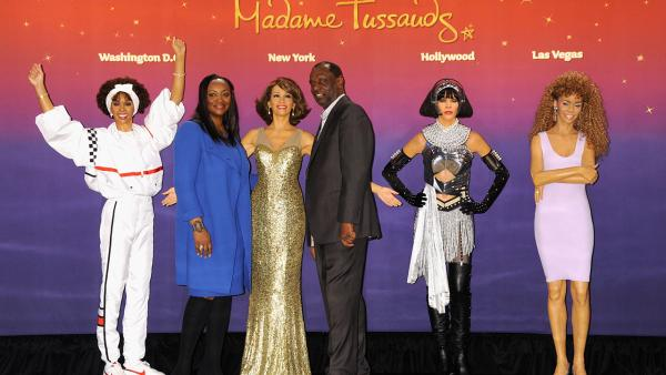 Gary Houston, brother of Whitney Houston, and wife Pat pose next to  one of four Madame Tussauds wax figures of the late singer that were unveiled on Feb. 7, 2013 in New York City. - Provided courtesy of Jennifer Graylock / Getty Images for Madame Tussauds