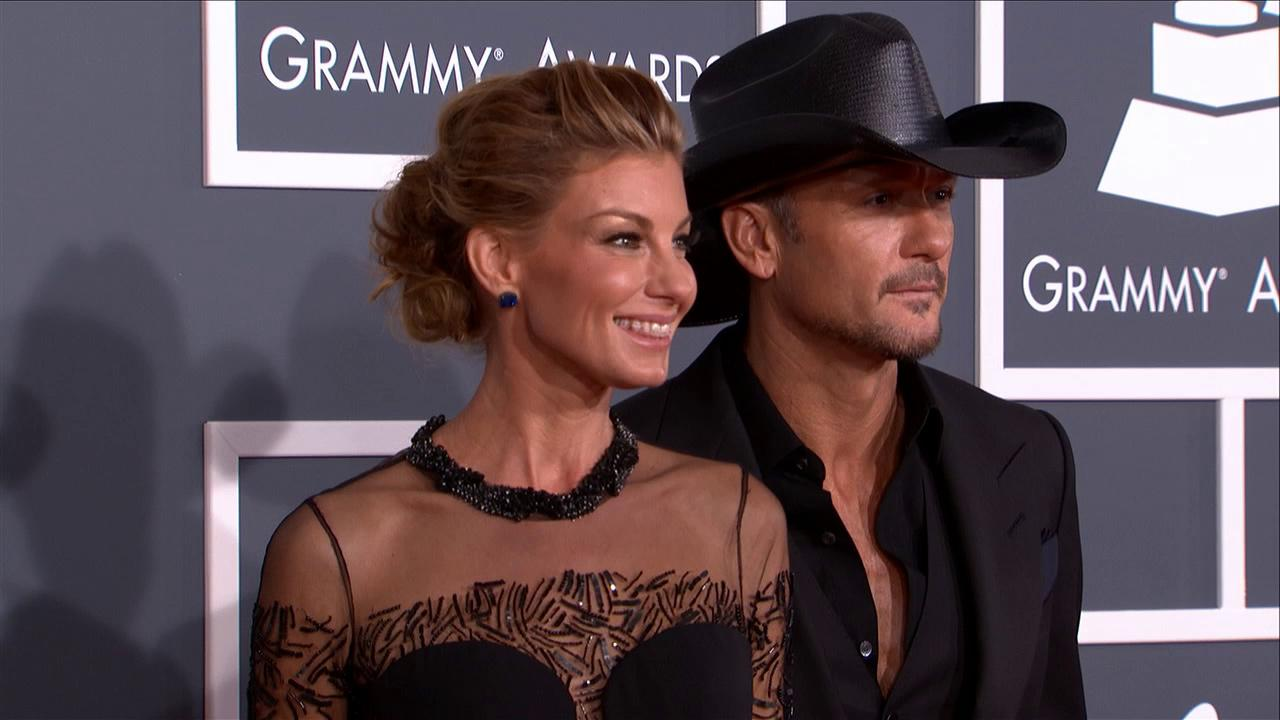 Faith Hill and husband Tim McGraw walk the red carpet at the Grammy Awards in Los Angeles on Feb. 10, 2013.