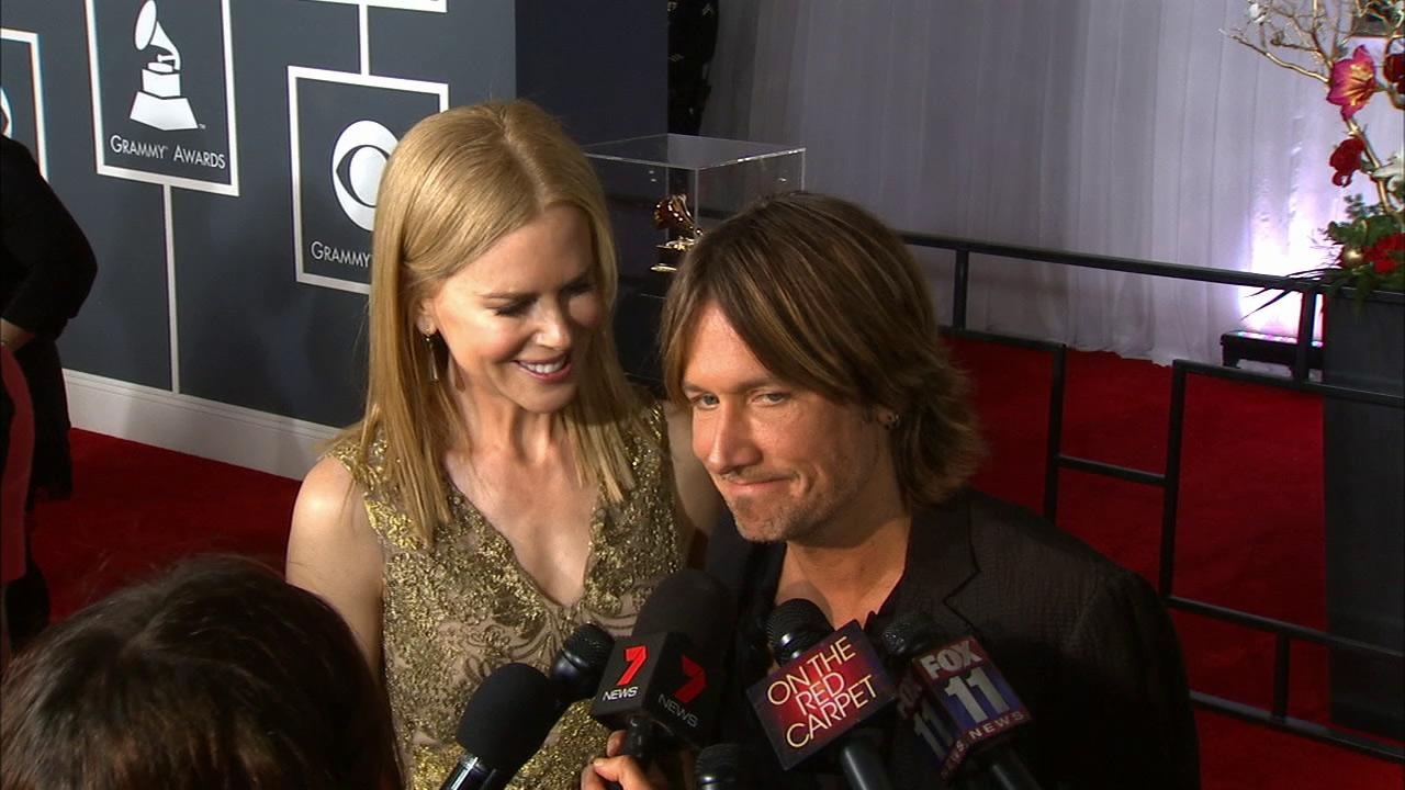 Keith Urban and Nicole Kidman act cute at the 2013 Grammys on Feb. 10, 2013.