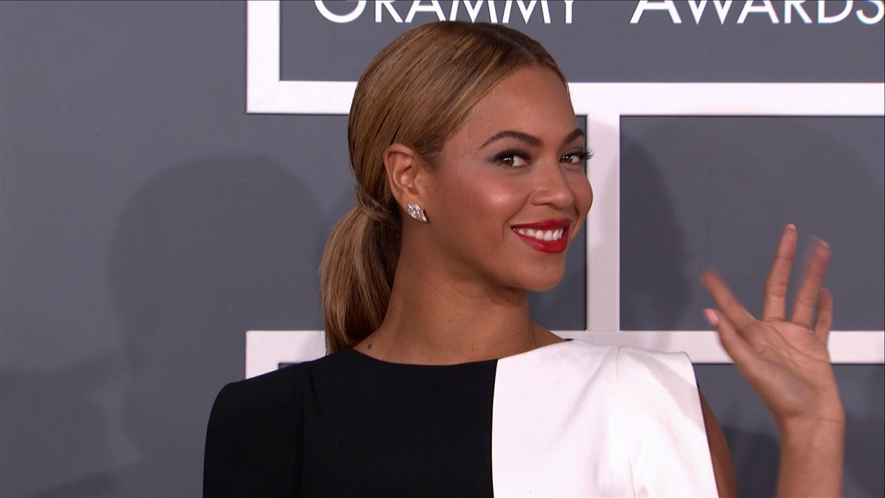 Beyonce wears a black and white Osman Spring 2013 jumpsuit on the 2013 Grammy Awards red carpet on Feb. 10, 2013.