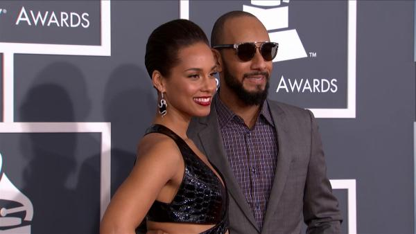 Alicia Keys and husband Swizz Beatz walk the red carpet at the 2013 Grammy Awards on Feb. 24, 2013.