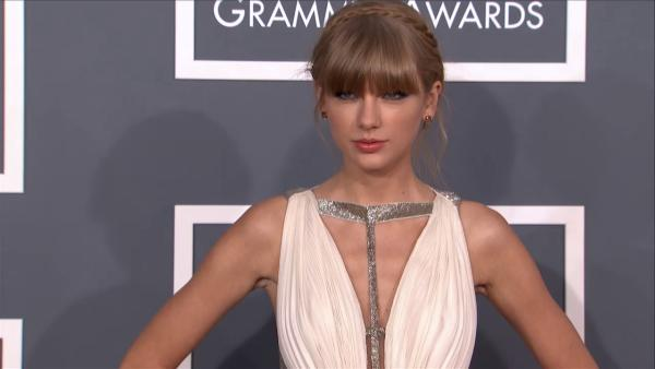 Taylor Swift wears a Grecian gown on the 2013 Grammy Awards red carpet on Feb. 10, 2013. - Provided courtesy of OTRC