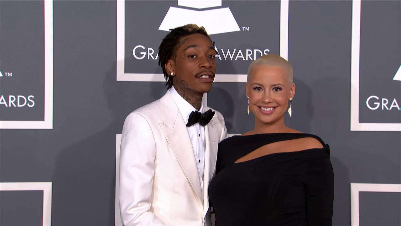 A pregnant Amber Rose and fiance Wiz Khalifa attend the 2013 Grammy Awards on Feb. 10, 2013.