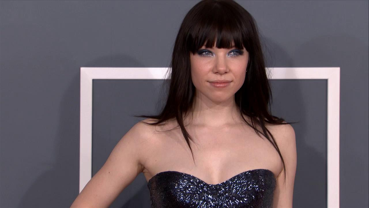Carly Rae Jepsen wears a black, sparkling Roberto Cavalli gown on the red carpet at the 2013 Grammys on Feb. 10, 2013.