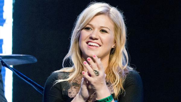 This Sept. 4, 2012 file photo shows singer Kelly Clarkson at the Pepsi NFL anthems kick off at Hard Rock Cafe in New York. - Provided courtesy of AP / Invision / Dario Cantatore