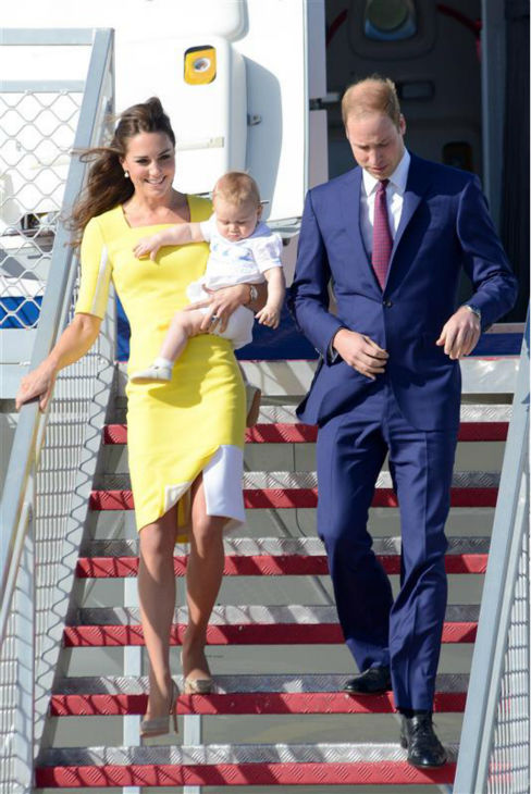 Kate Middleton, aka Catherine, Duchess of Cambridge, carrying son Prince George, and husband Prince William exit an airplane after landing in Sydney, Australia, as part of their Royal Tour. <span class=meta>(Paul McConnell &#47; Startraksphoto.com)</span>