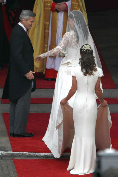 "<div class=""meta ""><span class=""caption-text "">Pippa Middleton appears at her sister Kate Middleton's Royal Wedding to Prince William at Westminster Abbey in London on April 29, 2011. Pippa became famous due to her a cowl-neck, body-hugging, ivory bridesmaid gown by Sarah Burton at Alexander McQueen. (AMH / Startraksphoto.com)</span></div>"