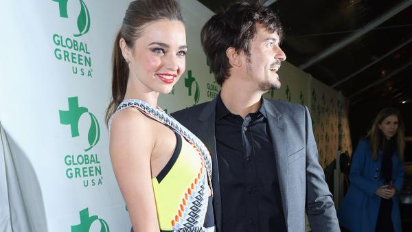 Victoria's Secret supermodel Miranda Kerr and husband and actor Orlando Bloom attend Global Green USA's 10th annual Pre-Oscars Party at the Avalon club in Hollywood, California on Feb. 20, 2013.