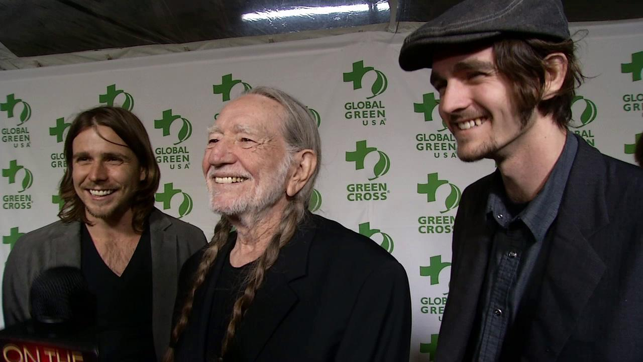 Willie Nelson and sons Jacob Nelson and Lukas Nelson talk to OTRC.com at the 2013 Global Green USA pre-Oscars party at the Avalon club in Hollywood, California on Feb. 20, 2013.