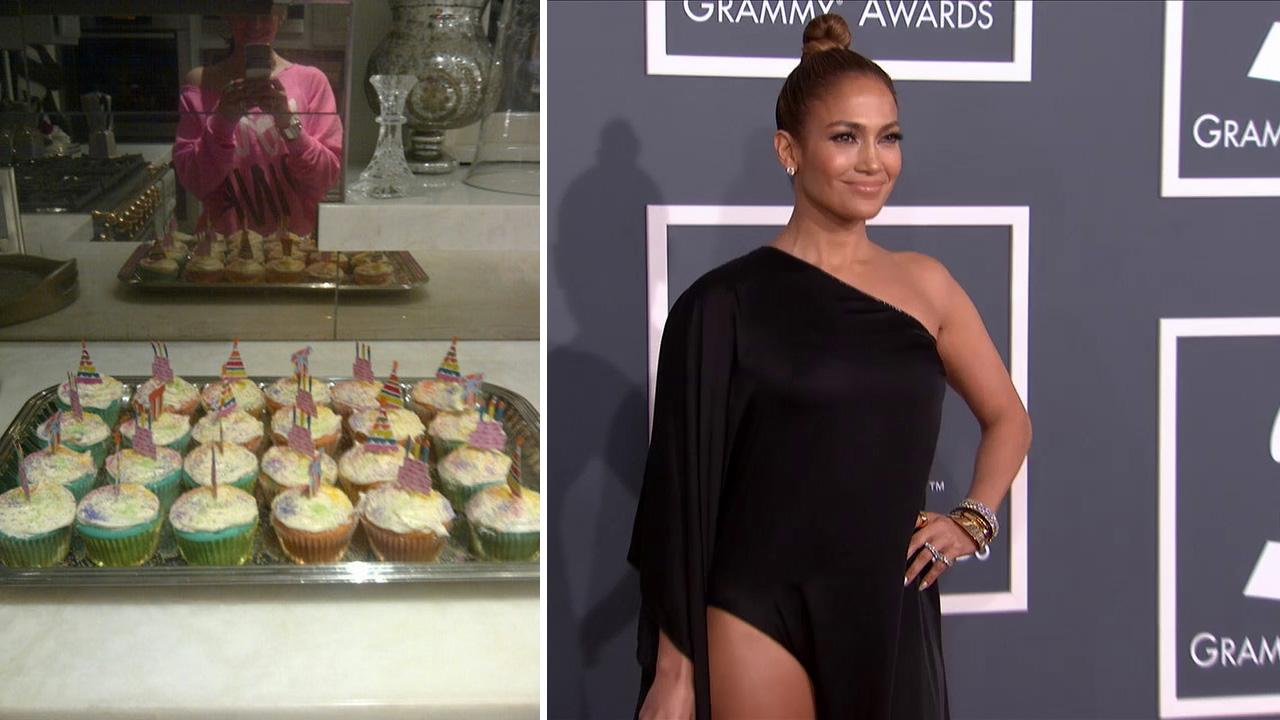 Jennifer Lopez posted this photo of the cupcakes she baked for her twins fifth birthday on Feb. 22, 2013. / Jennifer Lopez walks the red carpet at the 2013 Grammys on Feb. 10, 2013.
