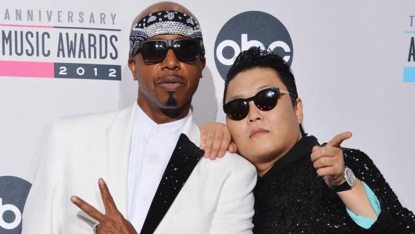 M.C. Hammer and PSY appear in a photo from the American Music Awards on November 18, 2013. - Provided courtesy of ABC