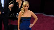Reese Witherspoon walks the red carpet at the 2013 Oscars on Sunday, February 24.