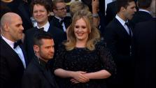 Adele walks the red carpet at the 2013 Oscars on Sunday, February 24.