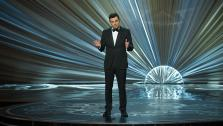 Seth MacFarlane appears on stage at the 2013 Oscars on February 24.