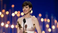 Anne Hathaway accepts her award for Best Actress in a Supporting Role at the Oscars on February 24, 2013.