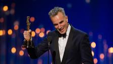 Daniel Day-Lewis accepts his award for Best Actor in a Leading Role at the Oscars on February 24, 2013.