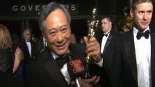 Ang Lee talks to OTRC.com before entering the Governors Ball after the 2013 Oscars. - Provided courtesy of OTRC