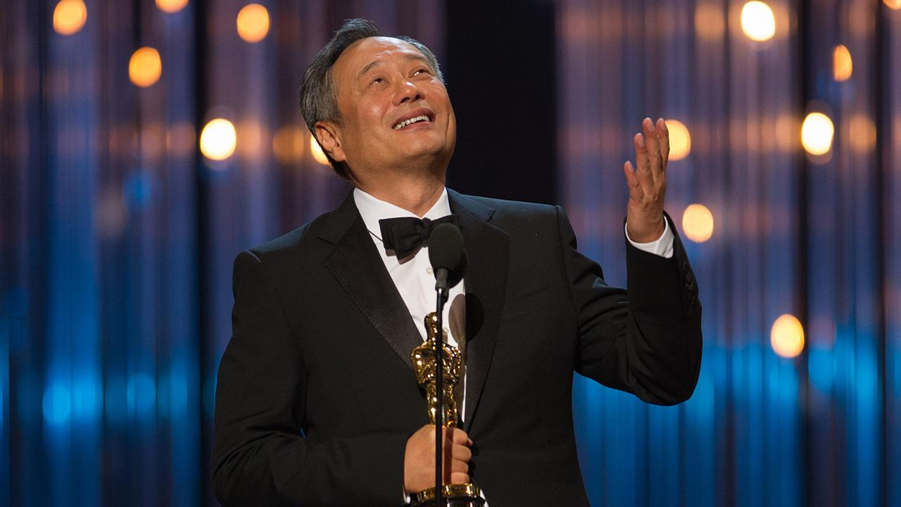 Ang Lee accepts his Oscar for Best Directing for Life of Pi at the 2013 Oscars in Los Angeles on Feb. 24, 2013.