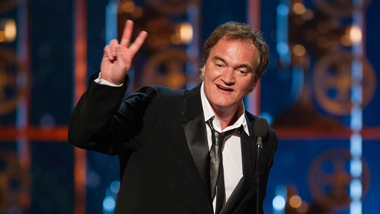 Quentin Tarantino accepts his Oscar for Best Writing (Original Screenplay) for Django Unchained at the 2013 Oscars in Los Angeles on Feb. 24, 2013.