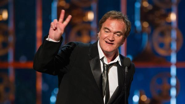 Quentin Tarantino accepts his Oscar for Best Writing (Original Screenplay) for Django Unchained at the 2013 Oscars in Los Angeles on Feb. 24, 2013. - Provided courtesy of Michael Yada / A.M.P.A.S.