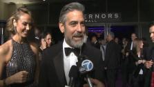 George Clooney talks to OTRC.com before entering the Governors Ball after the 2013 Oscars. - Provided courtesy of OTRC